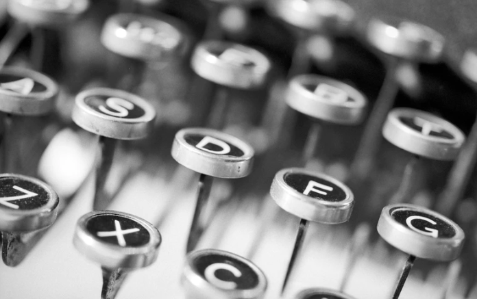 Silver old fashioned typewriter keys from A-G used to create high quality SEO content