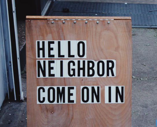 sign saying: hello neighbor come on in