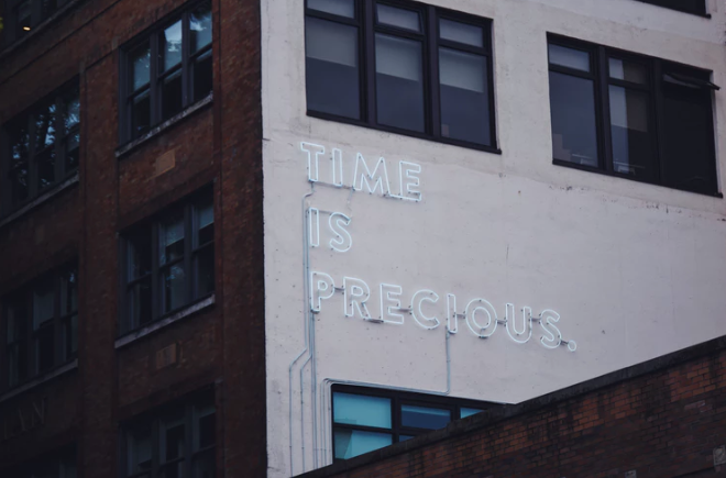 Time is precious signage on an urban brick building